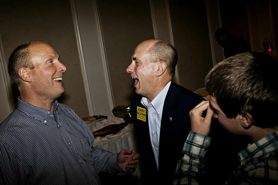 Gary Glenn, Republican candidate for the 98th District of the Michigan House of Representatives, laughs with State Senator John Moolenaar Tuesday during the Republican election party at the H Hotel in downtown Midland. Moolenaar won the race for the Michigan's 4th Congressional distract and Glenn defeated democrat Joan Brausch in the State House race. Photo: Sean Proctor/Midland  Daily News