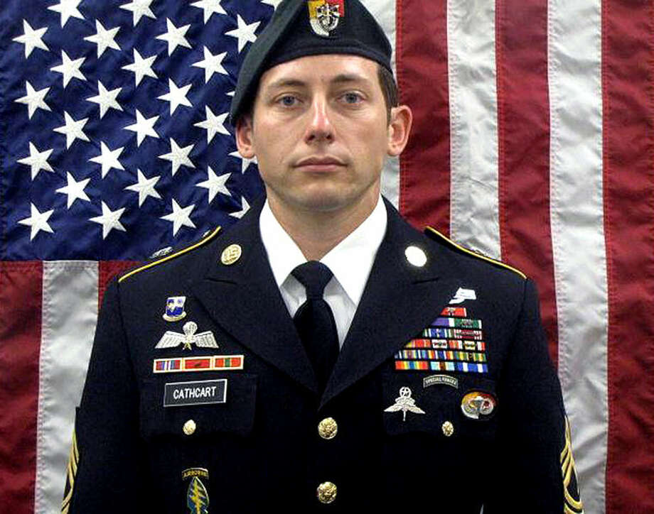 This undated photo released Sunday by the U.S. Army shows Sgt. 1st Class Michael Cathcart. Cathcart, a 31-year-old Green Beret from Bay City who served two tours of duty in Iraq, was killed Friday during combat operations in Afghanistan, according to the Pentagon. Photo:  AP Photo | U.S. Army