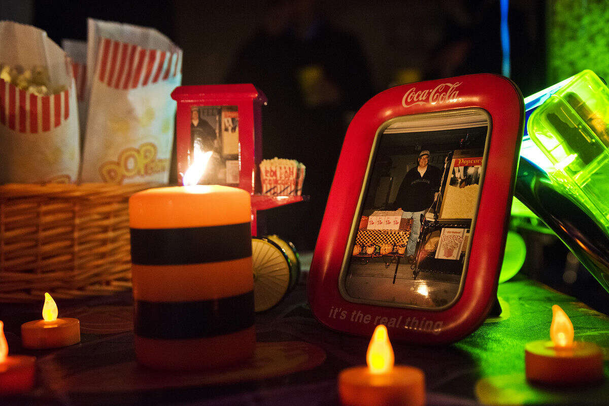 Candles surround photographs of the late Tim Troup at his home on Wild Pine Court in Midland on Friday, Oct. 31. Tim Troup, who passed away in August, handed out popcorn made in his old-fashioned popcorn maker each Halloween to visiting trick-or-treaters. His family decided to continue his tradition this year.