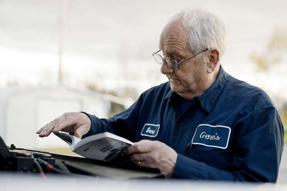 Coleman mayor Gene Robinson looks over the manual for his truck at his shop, Gene's Power Equipment, on Wednesday. Robinson is stepping down as mayor after 36 years in office. Photo: NEIL BLAKE | Nblake@mdn.net