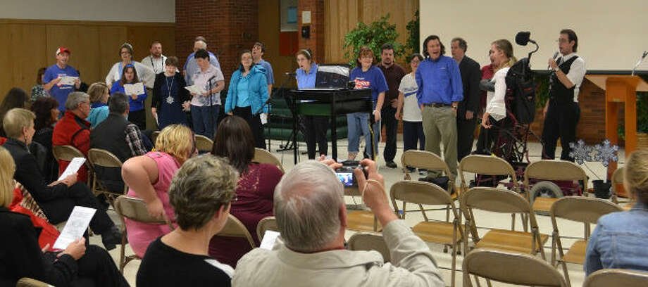 "Midland AKtion Club Talent Show performers and audience members sing ""Smile"" during the show's finale. Photo: Photo Provided"