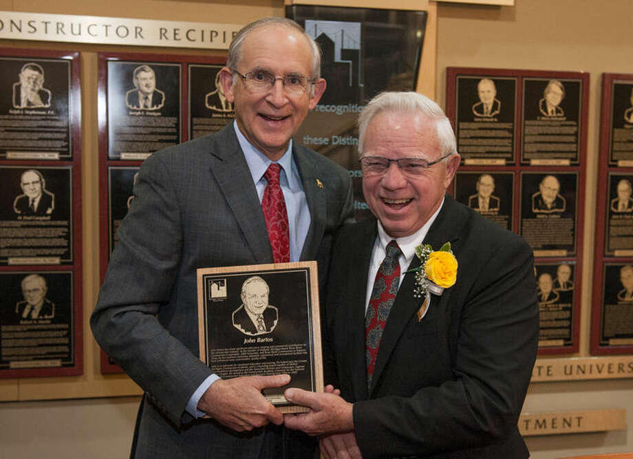 John Bartos, right, accepts the Michigan Construction Hall of Fame's 2014 Distinguished Constructor Award from Ferris State University President David Eisler. Photo: Bill Bitzinger