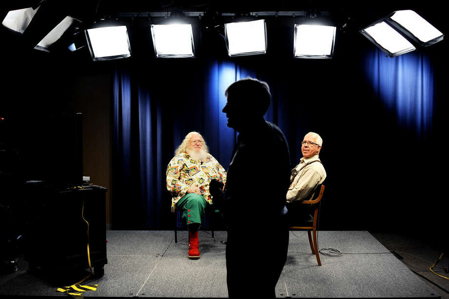 Charles W. Howard Santa Claus School Dean Tom Valent, right, and student John Bloomberg, left, get ready for an interview as Ron Beacom, MCTV station director, center, looks on. Photo: Daily News File Photo