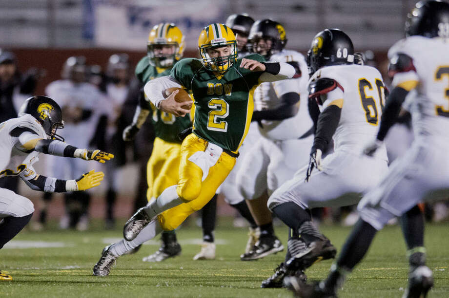 Dow quarterback Alec Marty runs the ball during the game against Traverse City Central at Midland Community Stadium on Friday. Photo: NEIL BLAKE | Nblake@mdn.net