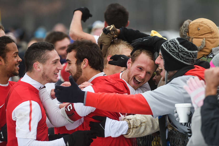 Saginaw Valley players celebrate with fans on the sidelines after the team scored against Northwood in the second round of the NCAA Men's Soccer Tournament at Northwood University on Sunday afternoon. Photo: ZACK WITTMAN | For The Daily News