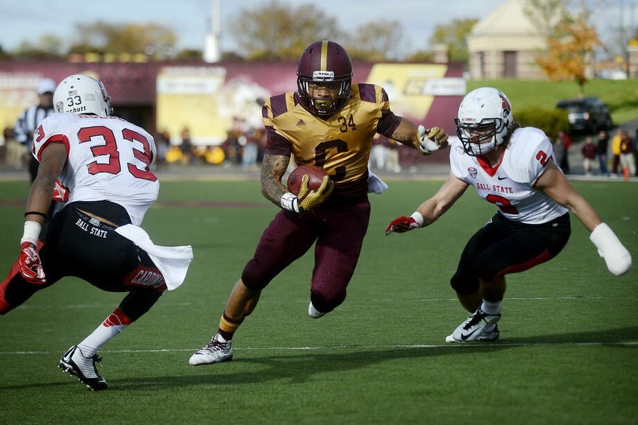When healthy, Central Michigan's Thomas Rawls is one of the best running backs in the MidAmerican Conference. Rawls, shown here playing against Ball State, is a graduate of Flint Northern. He's been hampered by injuries for much of the season. Photo: NICK KING | Nking@mdn.net