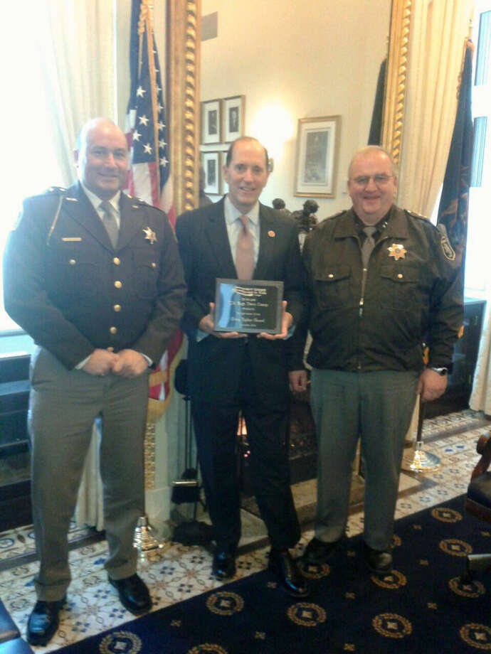 Midland County Sheriff Scott Stephenson, left, and Berrien County Sheriff Paul Bailey, right, recently went to Washington, D.C., to meet with U.S. Rep. Dave Camp, R-Midland. Photo: Photo Provided