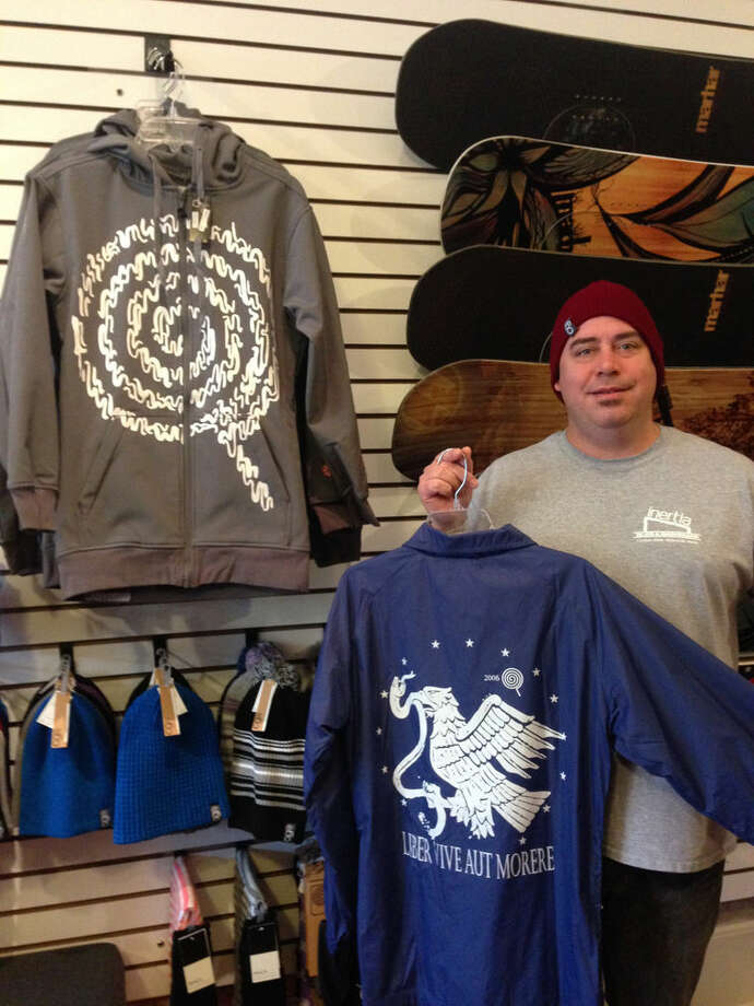 Nick Alfano, owner of Inertia Skate and Skateboard, holds attire from CandyGrind, a Colorado-based company owned by former area resident Brandi Lynn (Holsworth) Paik. Photo: Photo Provided