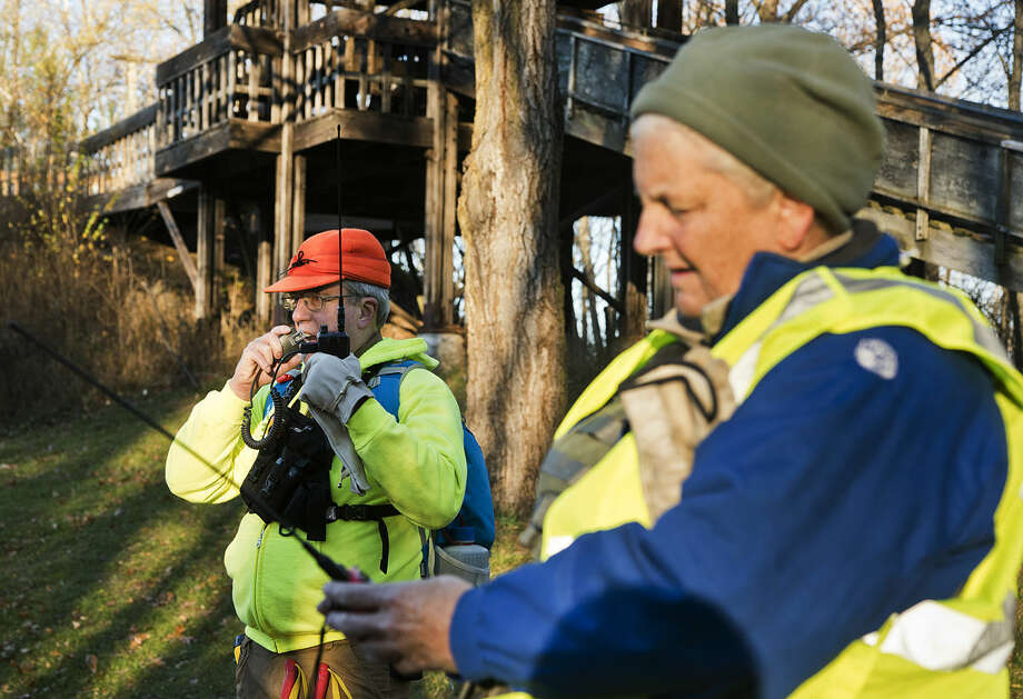 Dave Wallick, of Midland, left, and Wendy Gilbert, of Saginaw, check their radios during the Midland County Search and Rescue training session at Midland City Forest on Saturday. Wallick said he has been volunteering with the group for about a year; Gilbert has been a member for two years. Photo: DANIELLE MCGREW | For The Daily News