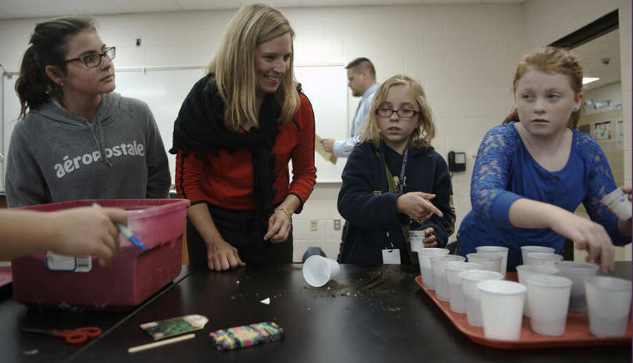 Bay City Western Middle School teacher Allison VanDriessche, second from left, instructs students, from left, Haleigh Chatterton, Amber Aspin and Katelyn Skelly. Photo: Photo Provided
