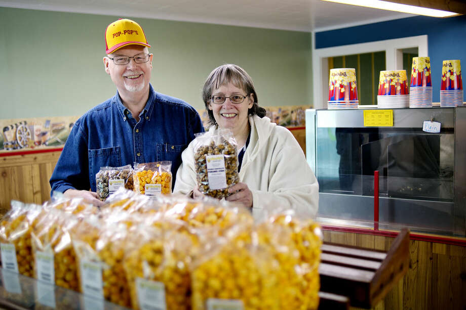 Gene and Pat McFarland have opened Pop Pop's, a gourmet popcorn and treat shop in Midland. Photo: NICK KING | Nking@mdn.net