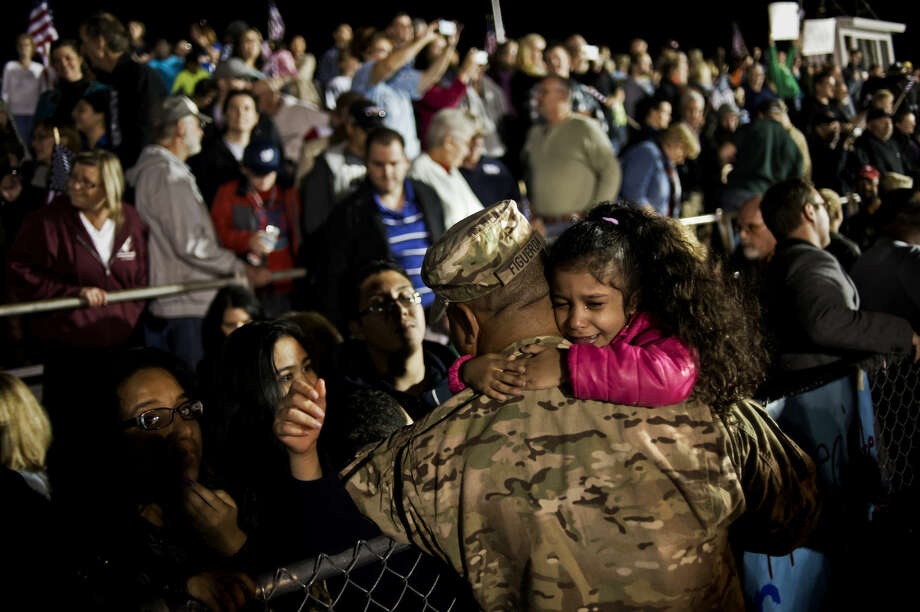 SEAN PROCTOR | sproctor@mdn.net Rafael Figueroa hugs his family after reuniting with them at the 1460th Transportation Company homecoming ceremony at H.H. Dow High School on Tuesday. The company was assigned to Operation Enduring Freedom in Afghanistan and completed over 180 missions in an area the size of Wyoming. Photo: Sean Proctor/Midland Daily News