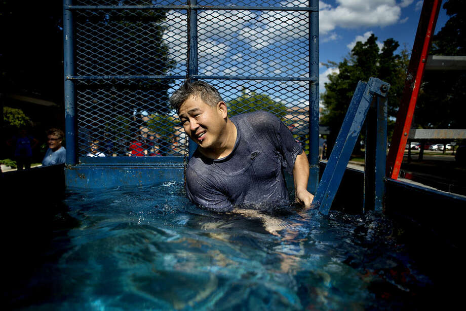 Associate Pastor Jung Eun Yum resets the seat after getting dunked in the water tank during the First United Methodist Church of Midland's Fall Kickoff for Christ event at the church on Sunday. Photo: NICK KING | Nking@mdn.net