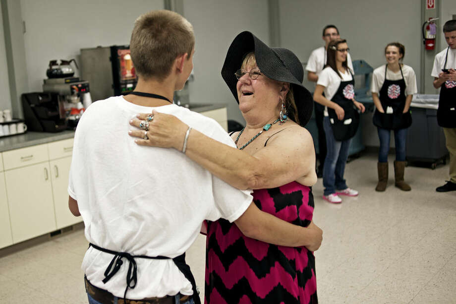 """Joy Crowl, of Beaverton, dances with her grandson, Colton Dark, 17, also of Beaverton, Wednesday during the grand opening formal dinner for the Sanford Senior Center. The center had been closed since April to undergo repairs following extreme flood damage. Most of the people who normally attended the center started visiting Trailside in Midland for meals and activities. Crowl and her husband, Dennis, said they were both happy to be """"back home."""" Photo: SEAN PROCTOR 