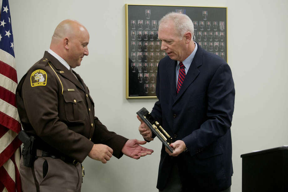 Midland County Sheriff Scott Stephenson accepts the Award of Excellence from Southern Folger President Donald Halloran on Wednesday morning at the Midland County Jail. The award is given for excellence in all areas from personnel to facility upkeep. Photo: NEIL BLAKE | Nblake@mdn.net