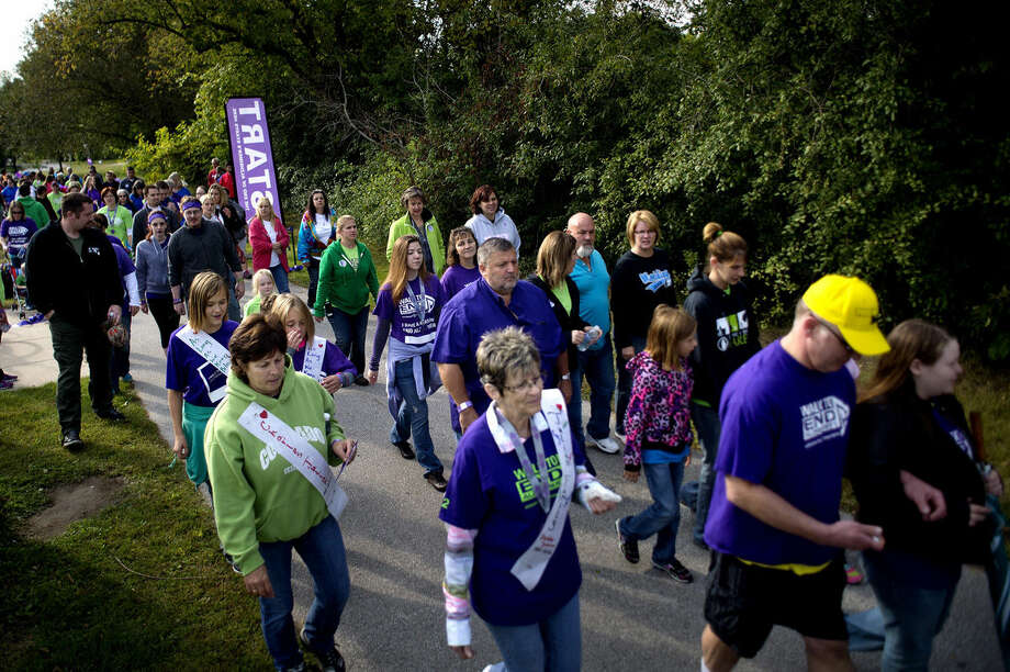 Participants leave the starting line at the beginning of the 2014 Walk to End Alzheimer's on Saturday at Emerson Park. Photo: NICK KING | Nking@mdn.net