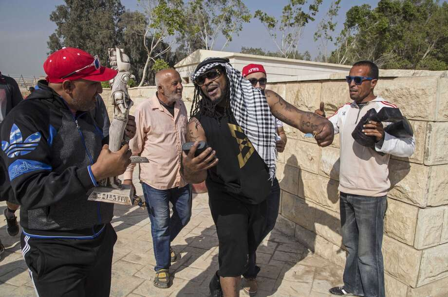 In this Monday, Feb. 29, 2016 photo, NFL football player Marshawn Lynch of the Seattle Seahawks, visits the Pyramids of Giza, in Cairo, Egypt. The players are on a visit to Egypt with American Football Without Barriers, a non-profit organization that educates disadvantaged children in the United States and overseas. In conjunction with the Egyptian Federation of American Football, AFWB will have free camps — basic, junior and advanced levels — for players ages 14-25, as well as a coaching clinic led by Breno Giacomini. (AP Photo/Roger Anis)