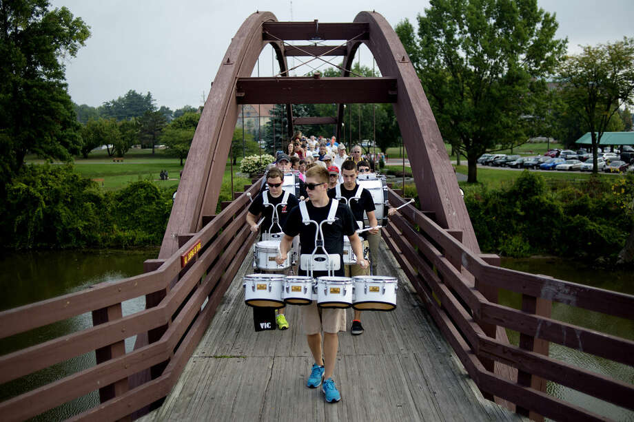 Members of the Resonators Drumline, led by Josh Weckesser, center, perform while participating in the Labor Day Tridge Walk on Monday. The annual walk was led by Mayor Maureen Donker and members of the drumline. This year's event was hosted by the two Midland Rotary Clubs. The event featured entertainment by The Jolly Hammers Dulcimer group, a visit from Great Lakes Loons mascot Lou E. Loon, donut holes and beverages and a drawing for prizes donated by local businesses. Photo: NICK KING   Nking@mdn.net