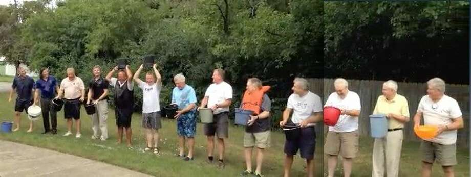 Pictured are, from left, the 13 Kiwassee members, who challenged the Midland Kiwanis, Morning Rotary and Noon Rotary Clubs to participate in this endeavor:  Kiwassee Ice Bucket Challenge organizer Dave Bender, Alex Rapanos, Roger Briggs, Mike Briggs, Jim Rajewski, Brian Goodwill, Bill Spaulding, Al Forster, Fred Honercamp, Bob Davidson, Ray Senesac, Cal Hoerneman and Bruce Rayce. Photo: Photo Provided