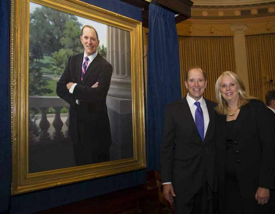 Congressman Dave Camp and wife, Nancy, at the official unveiling of his portrait. Currently chairman of the House Ways and Means committee, Camp will not be seeking re-election after serving in Congress since 1991. Photo: Photo Provided