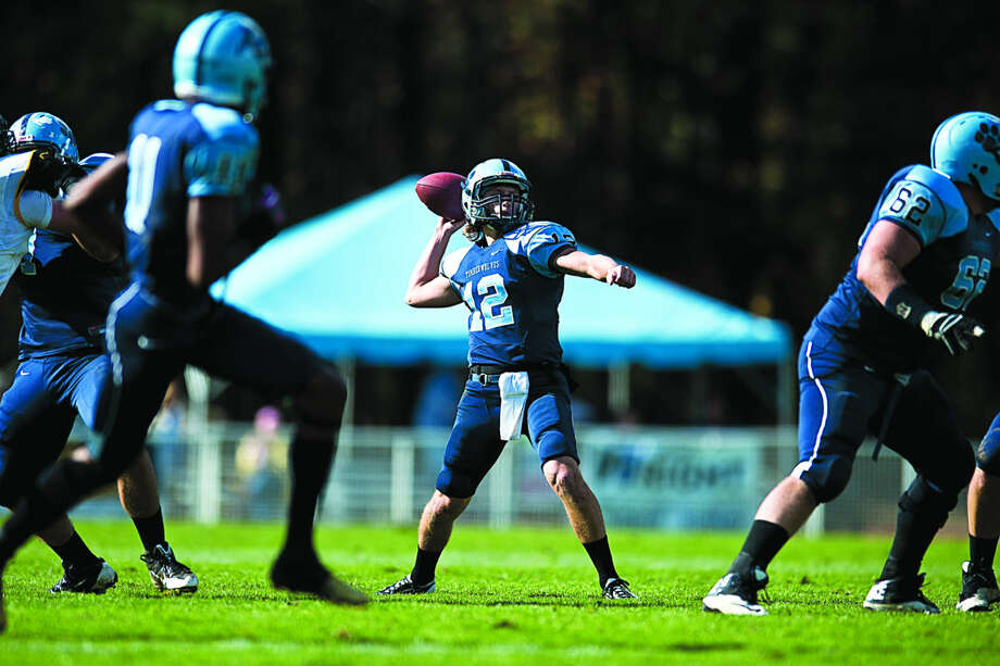 Northwood's Mark Morris, shown throwing a pass in a game last year, was one of two quarterbacks who played for the Timberwolves in last week's season opener. Northwood will play its home opener on Saturday against Ferris State. Photo: CHUCK MILLER | For The Daily News