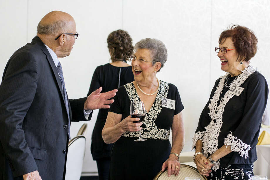 """Bob Weaver, Lois Crosby, and A. Louis Herringshaw, all 78 and all from Midland, laugh during their 60th Midland High School Reunion at the Midland Country Club on Saturday evening. The class of 1954 has a reunion every five years. """" We may have graduated 60 years ago, be we aren't old,"""" said Crosby. Photo: EMILY BROUWER 
