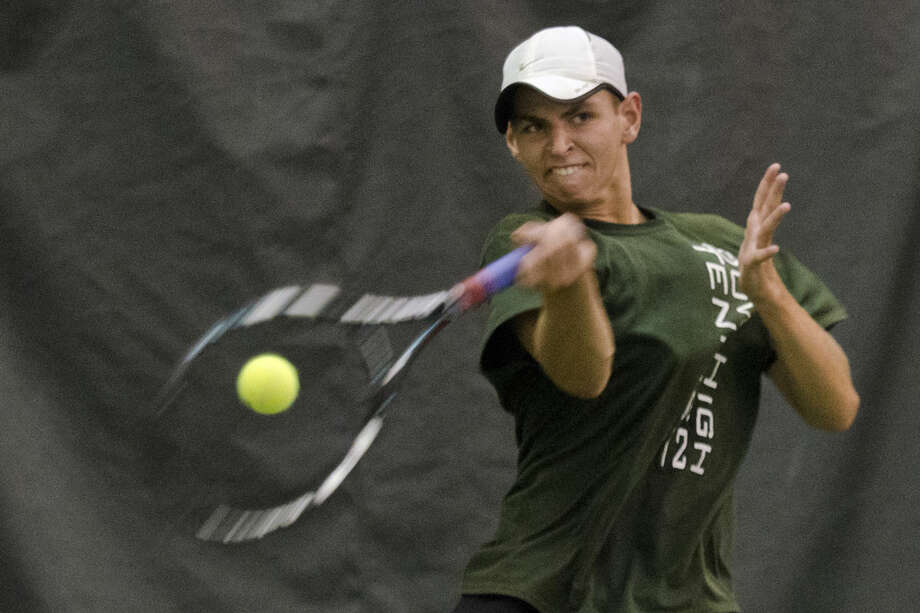 Dow junior Colin Angell hits the ball during a singles match against Forest Hills Central at the Midland Community Tennis Center on Wednesday. Photo: Danielle McGrew   For The Daily News