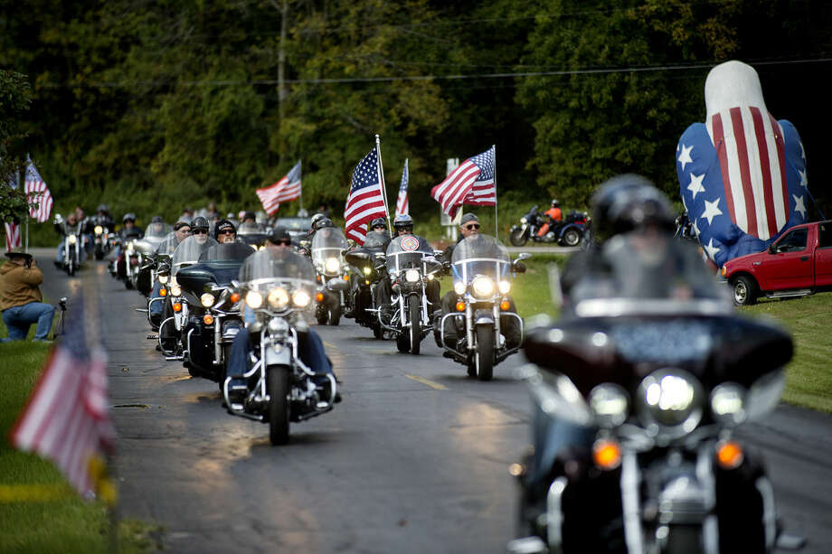 The motorcycle escort for the Michigan Traveling Vietnam Memorial Wall make its way down the driveway at the Sanford American Legion Post Saturday morning. Photo: NICK KING   Nking@mdn.net