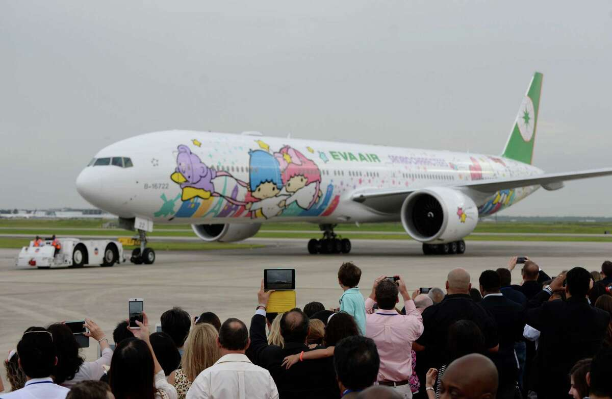 Fans take pictures of the EVA Air's Hello Kitty Shining Star Jet at an event celebrating its premiere Friday, June 19, 2015, in Houston. ( Jon Shapley / Houston Chronicle )