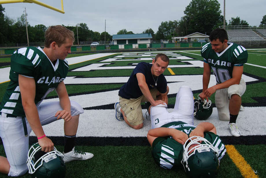 Athletic trainer Anthony Cilluffo works with Clare High School athletes during a recent practice. Teams associated with MidMichigan Health athletic training programs receive baseline concussion testing prior to contact sports. Photo: Photo Provided