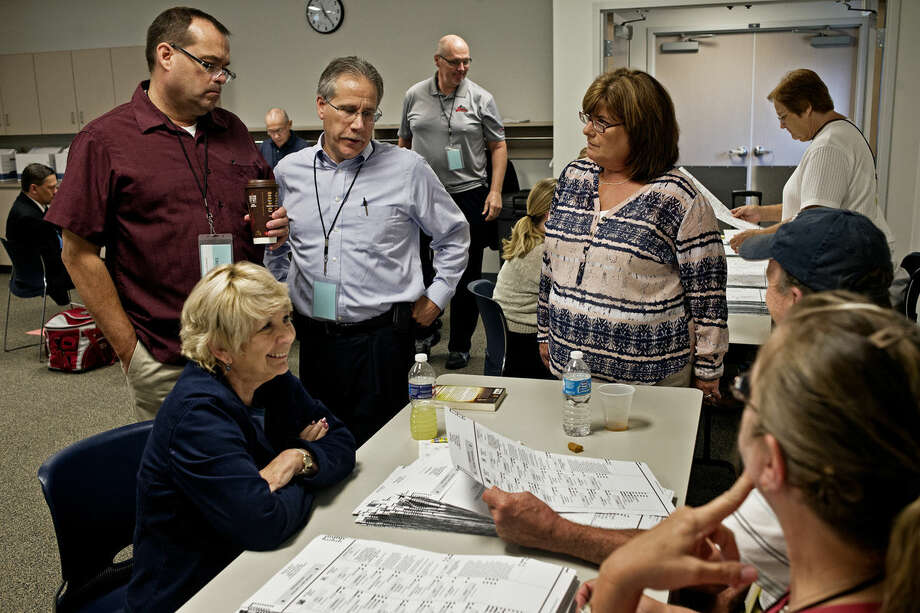 J.Dee Brooks, center, challenges a ballot during a recount for the Midland County Prosecutor's race between Brooks and Angelina Scarpelli Thursday morning at the Homer Township Public Safety building. Scarpelli requested a recount after losing the primary election race by 113 votes. Photo: SEAN PROCTOR | Sproctor@mdn.net