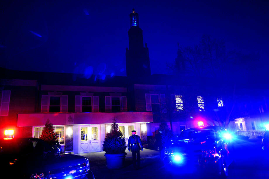 Midland police cruisers and fire trucks light up the entrance to Memorial Presbyterian Church as guests arrive for the Project Blue Light ceremony on Sunday. The lights in the church steeple were lit blue for the event as well. Photo: NICK KING | Nking@mdn.net