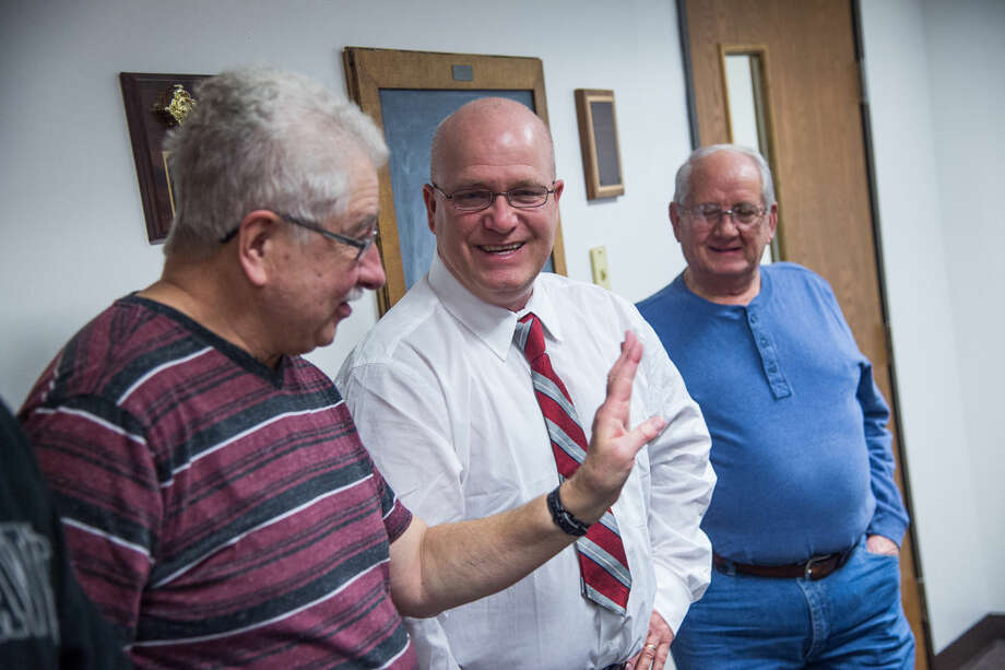 Newly sworn-in Mayor Steve Miller, middle, laughs with Coleman City Councilman Earl Marsh, left, and former Coleman Mayor Gene Robinson during a city council meeting on Tuesday night at Coleman City Hall. Photo: ZACK WITTMAN | For The Daily News