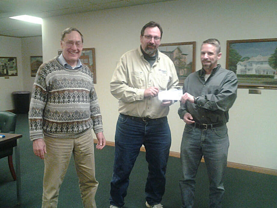 Pictured are, from left, Ed Lorenz, vice chair of the Pine River Superfund Citizen Task Force, Jim Hall, chair, and Theo von Wallmenich, project manager for CH2M HILL, EPA's contractor for the remediation of the plant site contamination. Photo: Photo Provided