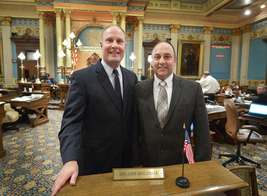 Sen. John Moolenaar, R-Midland, recently welcomed Dave Fisher, right, to the Michigan Capitol. Fisher is the chaplain of the Great Lakes Loons in Midland and was invited by Moolenaar to give the invocation to start the last day of Senate session for 2014.