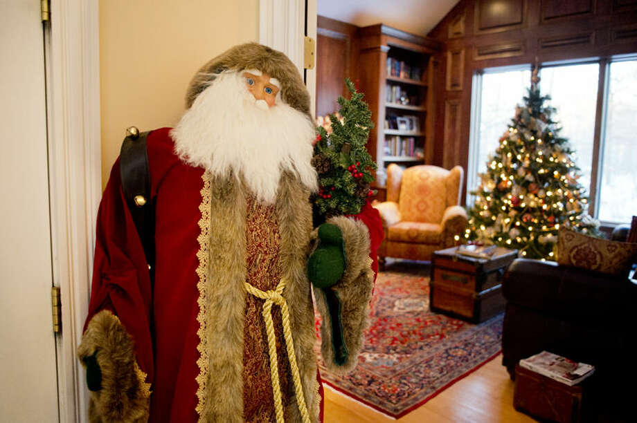 A life-size Santa figurine greets visitors to the study at Stephanie & Karl Stephan's home in Midland. Their house is featured on the Zonta Homewalk. Photo: NEIL BLAKE | Nblake@mdn.net
