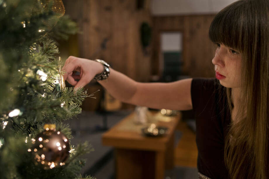 Autumn Hampton helps her mother, Michelle Hampton, decorate a Christmas tree in the sanctuary of the North Bradley Church of God. Photo: SEAN PROCTOR | Sproctor@mdn.net