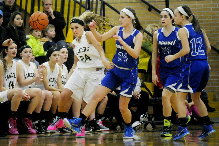 Bullock Creek's Ellie Juengel, right, steals the ball from Nouvel's Nicole Buckingham as Buckingham's teammates, from left, Madison Graham and Alex Joynt look on during the first quarter on Monday at Bullock Creek High School. Photo: NICK KING   Nking@mdn.net