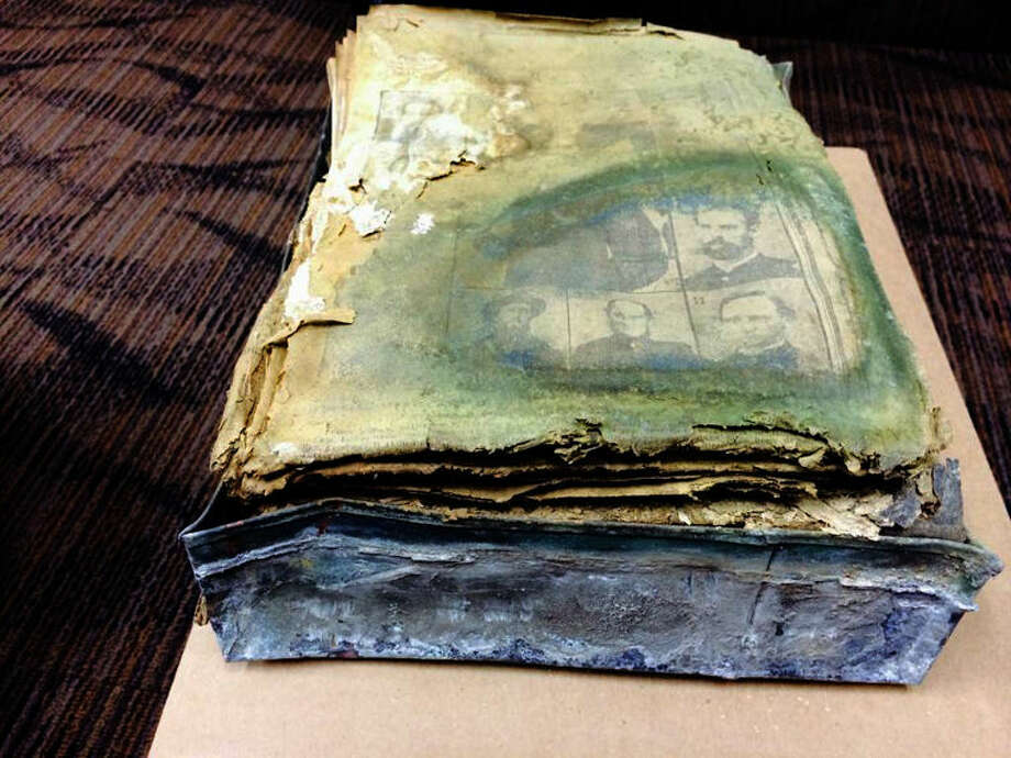 The water-damaged contents found in a 100-year-old time capsule retrieved from Bliss Park in Saginaw are shown prior to the restoration work being done by SERVPRO of Saginaw and DFD Document Restoration Services. Photo: Photo Courtesy Of SERVPRO Of Saginaw