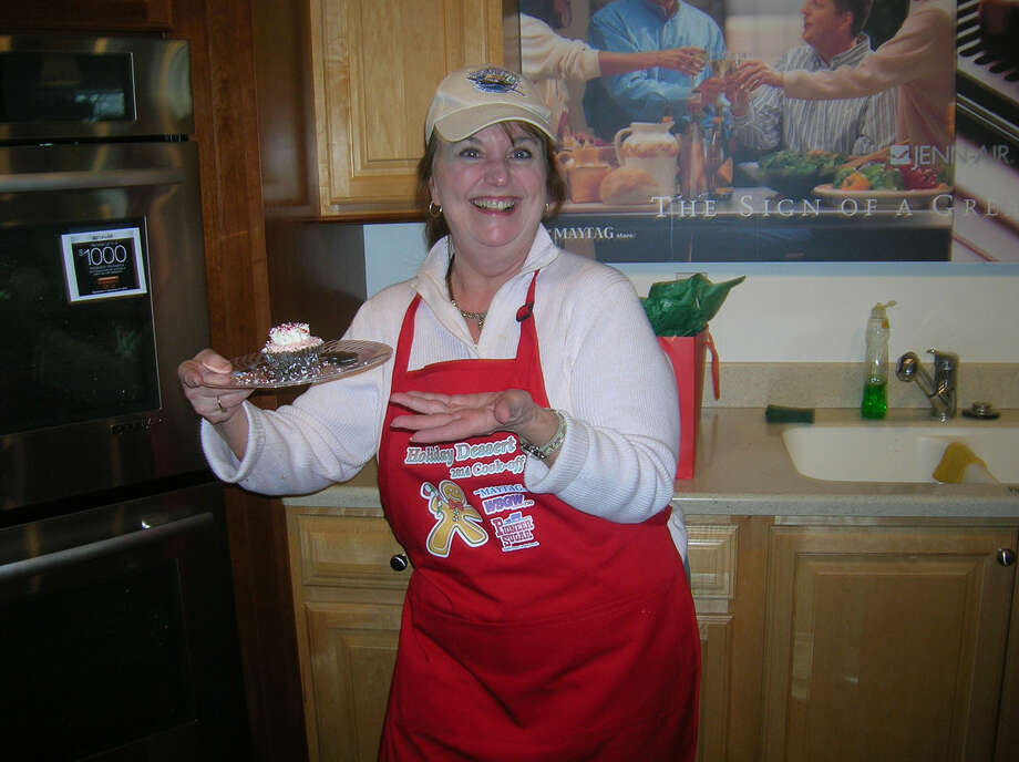 Dolly Votruba of Saginaw shows off her winning cupcake during the 2014 WSGW & The Maytag Store Holiday Dessert Contest with Pioneer Sugar. Photo: Pati LaLonde | For The Daily News