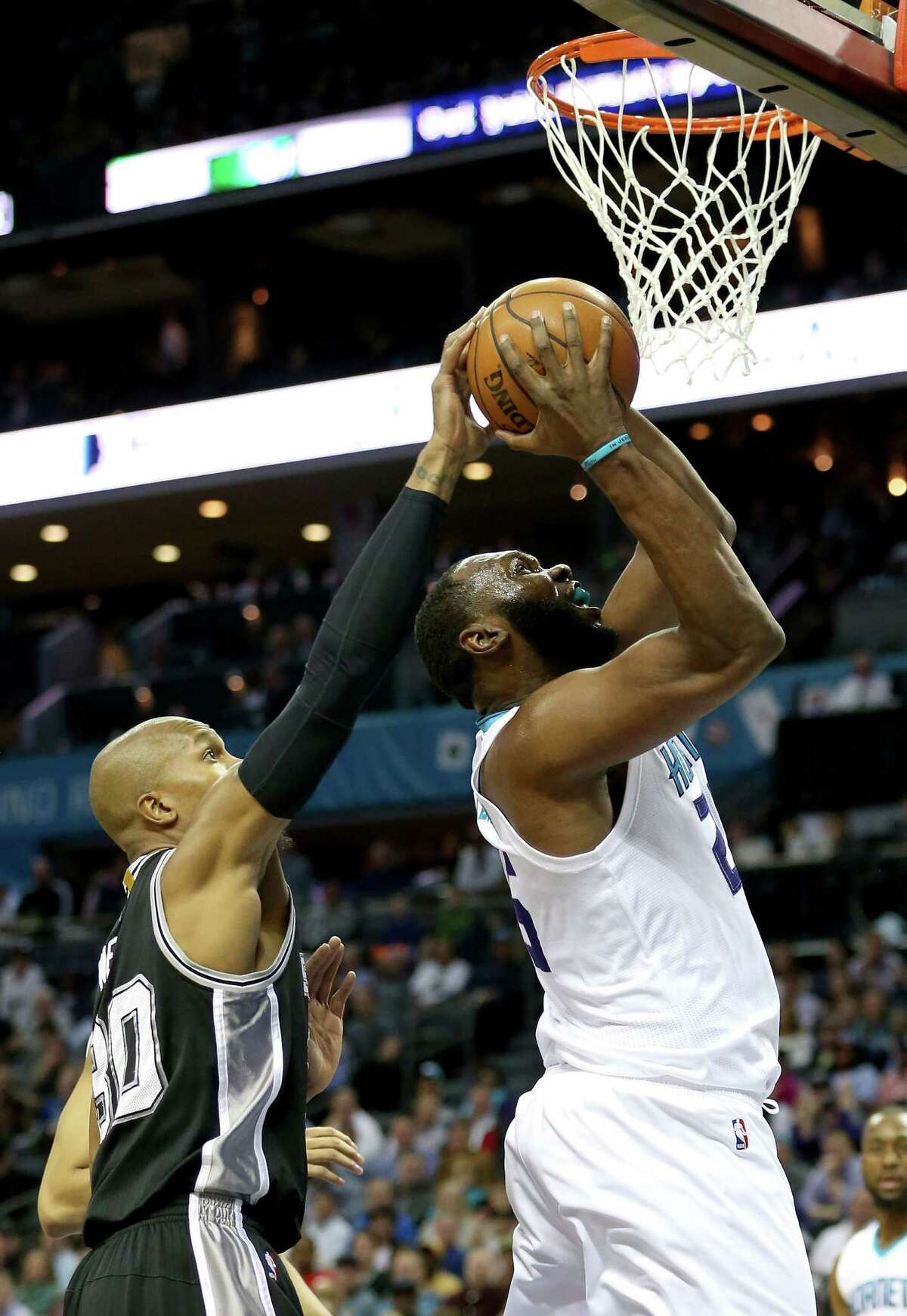 CHARLOTTE, NC - MARCH 21: David West #30 of the San Antonio Spurs tries to stop Al Jefferson #25 of the Charlotte Hornets during their game at Time Warner Cable Arena on March 21, 2016 in Charlotte, North Carolina.NOTE TO USER: User expressly acknowledges and agrees that, by downloading and or using this photograph, User is consenting to the terms and conditions of the Getty Images License Agreement.