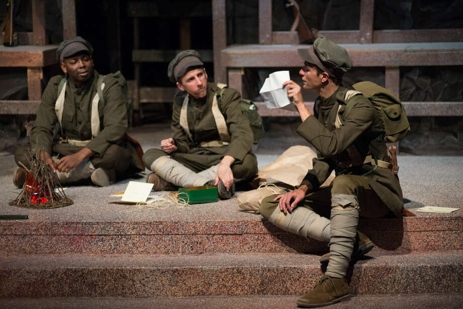 """Private Philip Osbourne - Isiah Barnes, Private Theodore """"Teddy"""" Jones - Ben Price and Private Thomas Pfeiffer - Jared Lane in the Midland Center for the Arts Center Stage Theatre """"In Fields Where They Lay."""" Photo: STEVEN SIMPKINS 