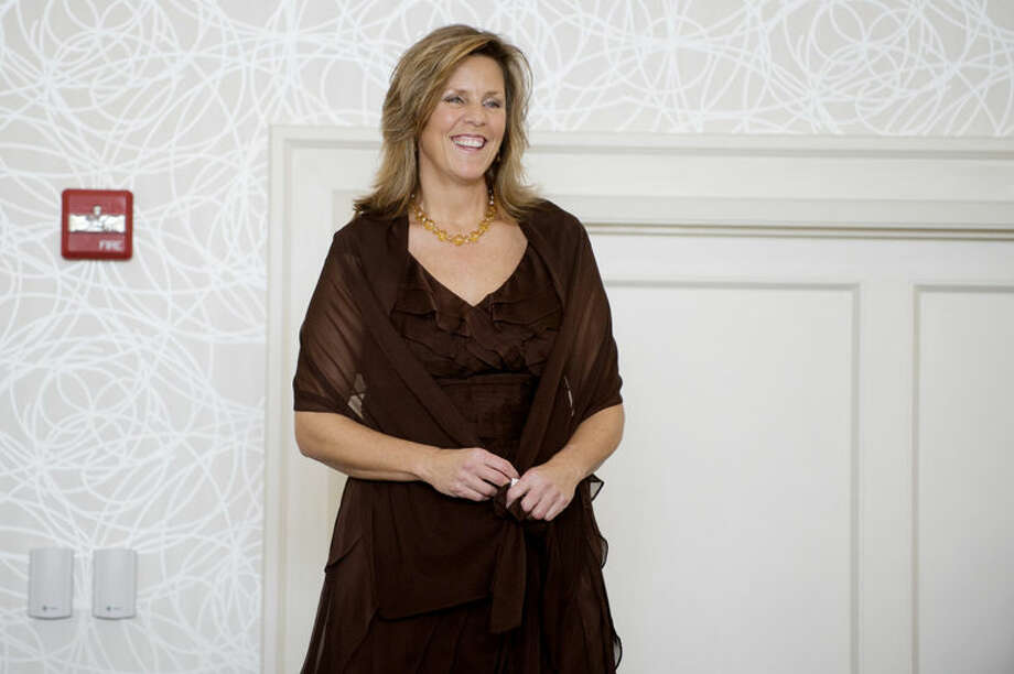 Sue Genau models a dress from Willow for the Cancer Services 23rd Annual Holiday Luncheon and Style Show on Wednesday at the Midland Country Club. During the event doctor John Pfenninger was honored and cancer survivors modeled clothing from local retailers. Photo: Neil Blake/Midland Daily News