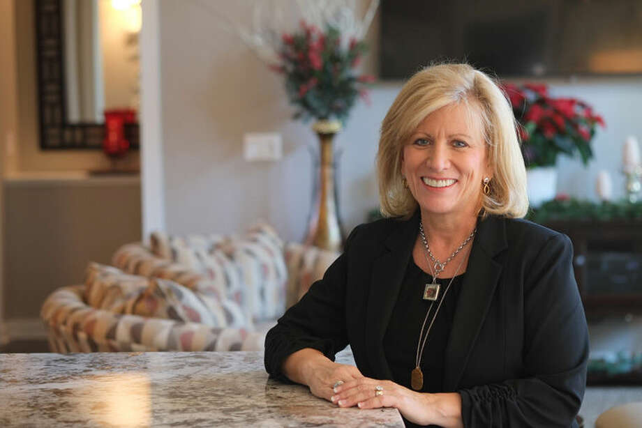 Shelly Acker of Midland is among the Cobblestone homeowners who will welcome visitors during the inaugural Homes for the Holidays event, which will provide funds for purchasing advanced breast cancer detection equipment for MidMichigan Health. Photo: Photo Provided
