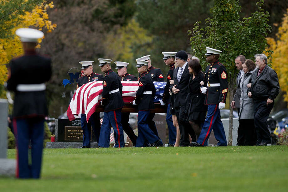 Marine honor guard members carry the casket of Lance Cpl. Steven Szymanski to the burial site at the Midland Municipal Cemetery in October. Szymanski, of Midland, died on Tuesday, Oct. 21, at Fort Bragg, N.C., during a training exercise. Photo: NEIL BLAKE | Nblake@mdn.net