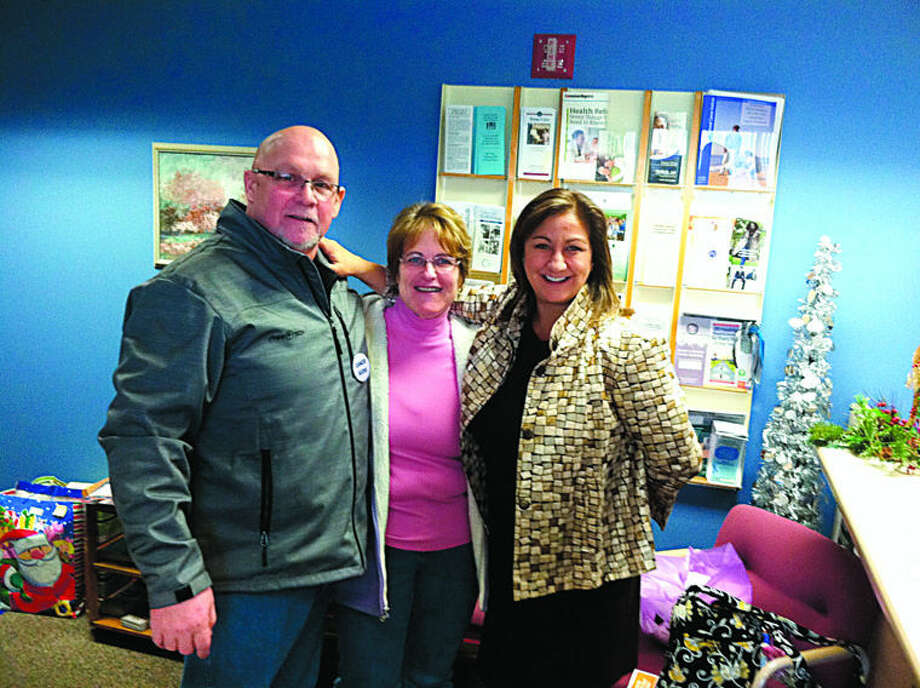 Ron and Vickie Shauger stand with Julie Nunn, executive director of Cancer Services of Midland. Ron faces a number of health challenges and his family receives support through Cancer Services. Photo: Photo Provided