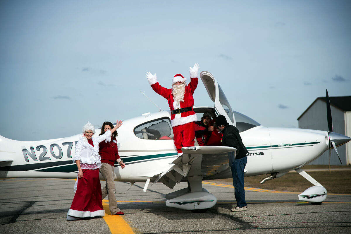 Santa Claus and Mrs. Claus arrive at Barstow Airport in Midland Sunday.