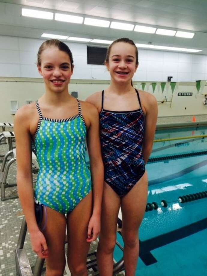 Midland Dolphins' swimmers Claire Newman, left, and Anna Jensen will compete for Team Michigan at the 2015 Mid-States All-Star Championships this Saturday and Sunday in Indianapolis.