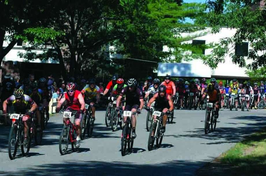 And they're off at the start of last year's Sweat Shaker Mountain Bike Race on the campus of Mid Michigan Community College. Photo: Photo Provided