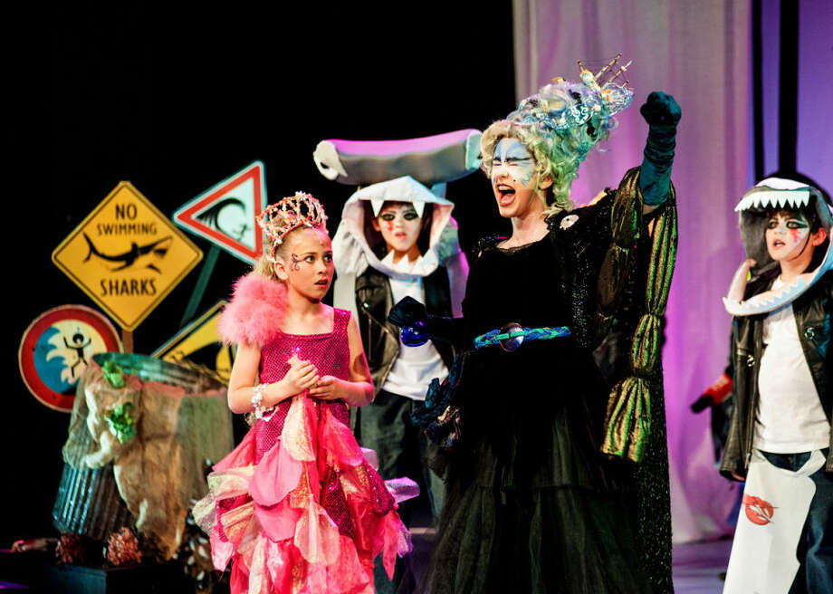 """From left, Oliviah Klinski as Anemone, Kyle James Kotanchek as Ziptide, Hannah Woehrle as the Sea Witch, and Kefir Klee as Riptide, act out a scene during a rehearsal of the Peanut Gallery's production of the """"Little Mermaid"""" Tuesday at the Midland Center for the Arts. Photo: STEVEN SIMPKINS 